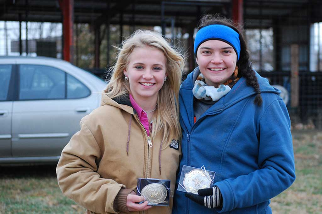 Kyra and Sabrina won the belt buckle for their age divisions.